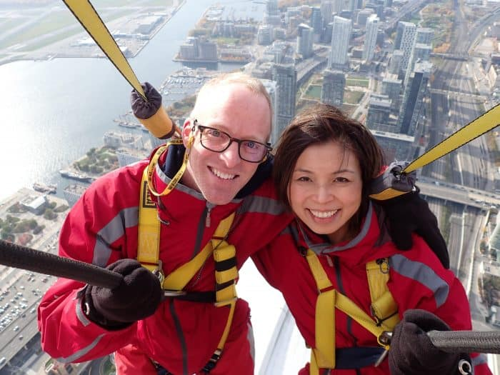 Clinton and Loni Stark walking CN Tower rim 2016