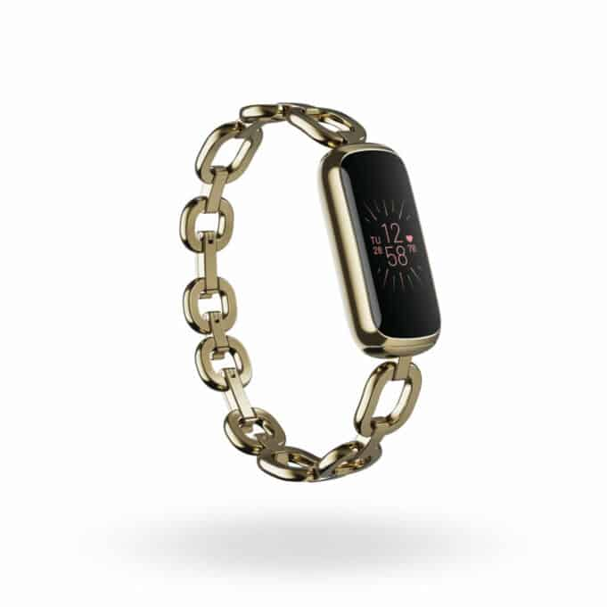 Fitbit Luxe fitness and wellness tracker with soft gold stainless steel gorjana Parker link bracelet