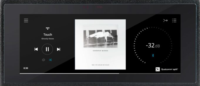 NAD M10 V2 close-up of the 7-inch IPS display user interface and album art